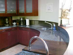 Kitchen, mahogany cabinets,curved granite counters
